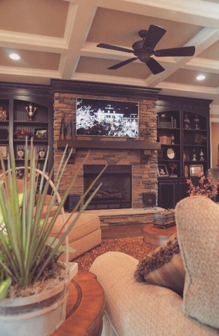 Room design coffered ceiling stone fireplace and built for Living room built in cabinet designs