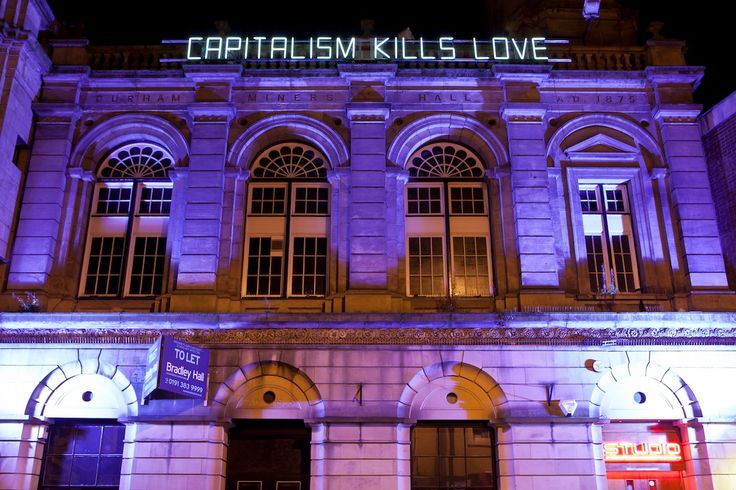 'Capitalism Kills (Love)', Claire Fontaine, Lumiere Durham 2011. Also situated on the former Durham Miner's Hall, the piece highlighted injustices and inequalities of modern life.  Photo by Matthew Andrews.