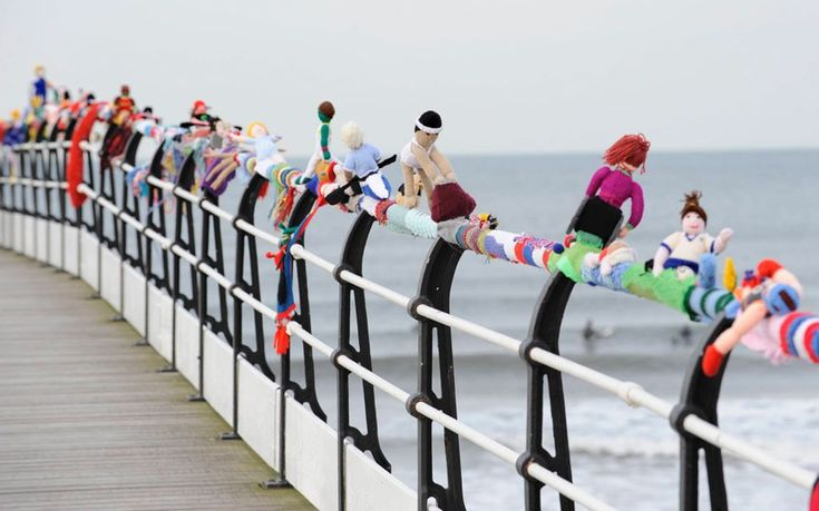 The knitted Olympics left on an English seaside pier by a mystery knitter.