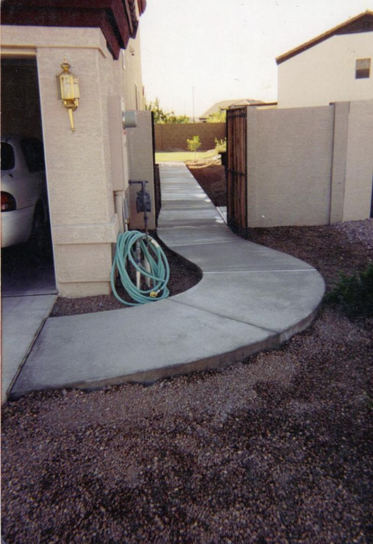Concrete path on side of house