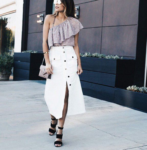 A ruffled chiffon blouse with a denim skirt and heels.
