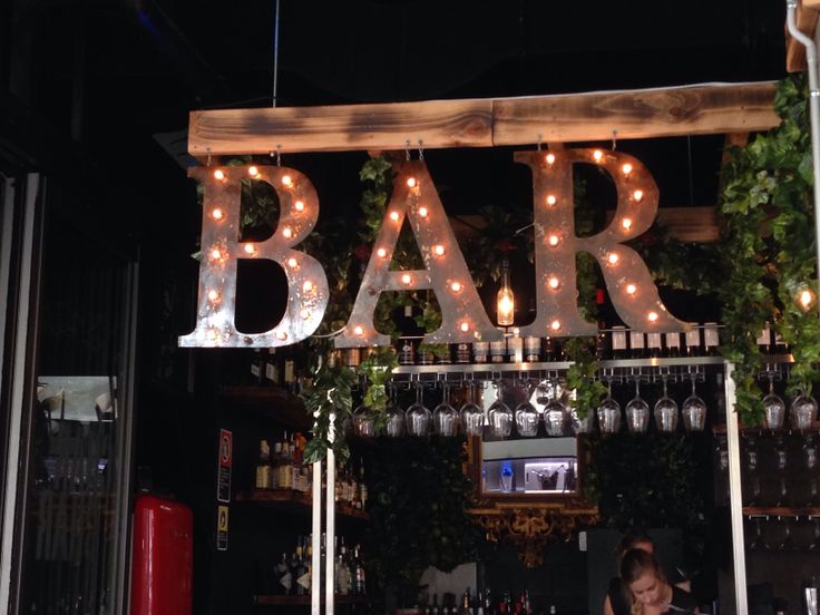 'BAR' in serif typeface cut out of metal at Char Char, Wollongong