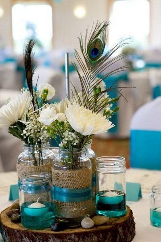Rustic Peacock Wedding Centrepieces / http://www.himisspuff.com/rustic-wedding-centerpiece-ideas/19/