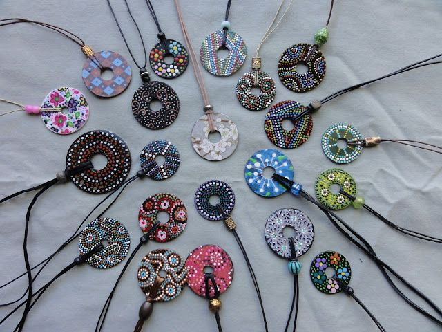 You could make these by painting large washers and hemp string for the necklace.