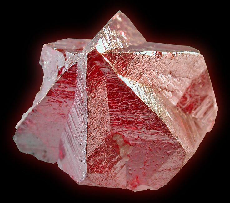 "Cinnabar- mercury(II) sulfide (HgS), native vermilion), is the common ore of mercury.    Locality: Tongren Mine, Tongren Co., Tongren Prefecture, Guizhou Province, China  Cinnabar, interpenetrating ""drill bit"" twin, 20 mm. wide, Tongren Mine, China. K. Nash specimen & image."