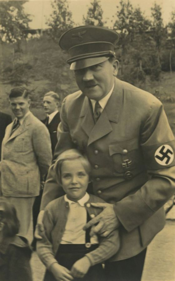 * Adolf Hitler posing with a little girl at the Berghof *