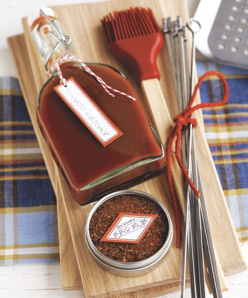 Show you really care with a bottle of homemade ketchup! Add a DIY dry rub, skewers, and a basting brush, and present it all on a cutting board, wrapped in cellophane and tied with a bow.  (Similar: bottle, $4.49; containerstore.com; Masterpiece Studios tins, $13.90 for 12; amazon.com; KegWorks skewers, 95 cents each; amazon.com; basting brush, $10; surlatable.com; CentralChef bamboo cutting board, $8.99; amazon.com)   - CountryLiving.com
