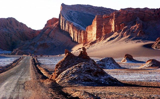 """Valle de la Luna Best Desert Landsacpes Valle de la Luna is placed in the Atacama Desert in Chile. This stunning desert landscape is the consequence of hundreds of years of winds and surges on the sand and stone of the locale. The huge sand ridges and stone arrangements emulate the surface of the moon, giving the locale its name, which means """"Valley of the Moon""""."""