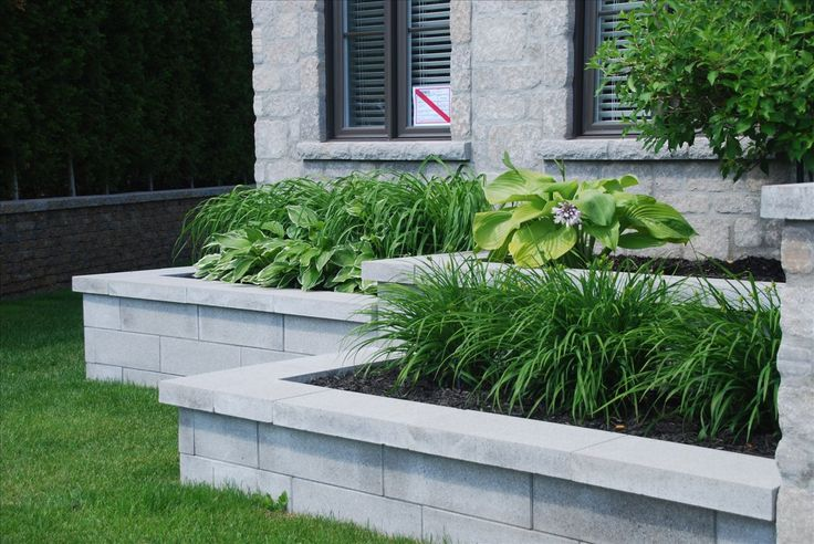 Clean and modern retaining wall made with polished pavers. This would look great around a semi-inground pool. Not sure what product is used here, but the work was done by Pavé Nord-Sud so must be either Rinox, Permacon or Techo-Bloc.