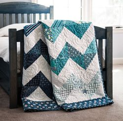 try this quick and easy way to make four triangle-squares in one fell swoop.  produce a whole wave of them and your quilt will be almost done!