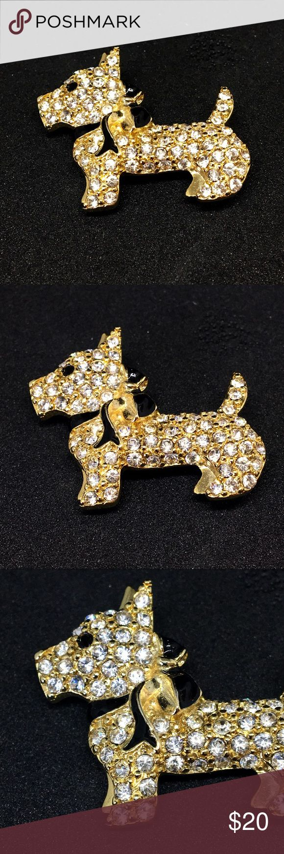 "Monet Scottie Dog Crystal Enamel Pin Vintage Monet scottie dog crystal and enamel pin brooch. Gold tone metal scottie dog with pavé crystal rhinestones. Has a black enamel scarf and black crystal eye. Signed Monet. Pin works perfectly and is in immaculate condition. Measures 1 1/2"" by 1 1/4"" at tallest point. Vintage Jewelry Brooches"