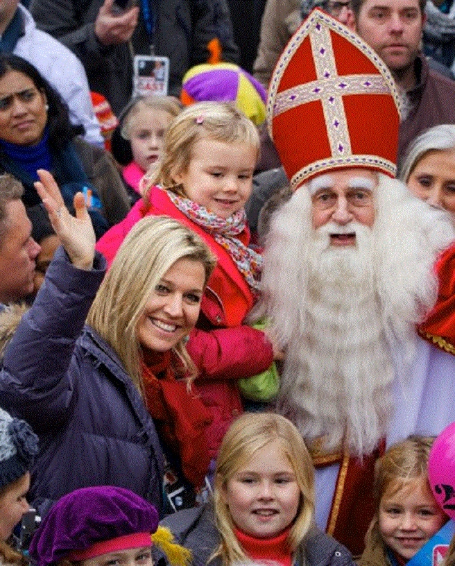 Queen Maxima with her daughters (L)Princess Amalia, (R)Princess Alexia and (L)Princess Ariane held by Sinterklaas. The Netherlands