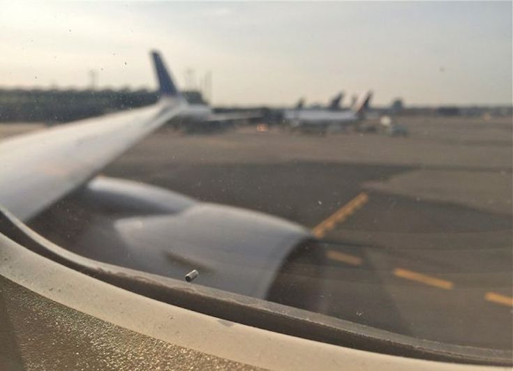 Why airplane windows have tiny holes