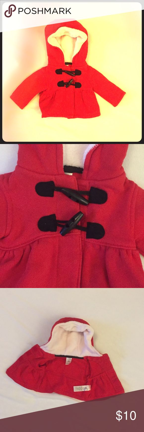 Cozy Red Newborn Coat with Black Toggle Buttons She will be warm all winter in this cozy coat featuring a toggle button design and a warm lined hood.   Your little girl will be absolutely adorable wearing this little coat. The pictures do not due this little coat justice. You will love putting your little one in this coat. Carter's Jackets & Coats Pea Coats