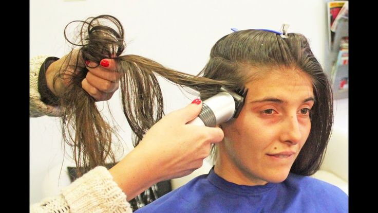 Hair clipper running her long hair to shave both sides of her head
