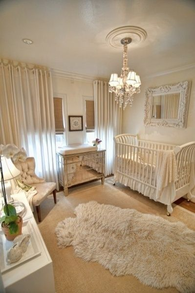 Great baby room ideas @ideasbabyroom.com! Who would have thought a white fluffy rug and a mirror above the crib could be so modern, warm and elegant! LOVE THIS