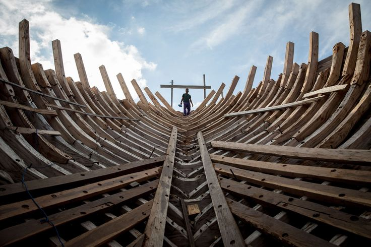 SOUTH SULAWESI, INDONESIA A Buginese man holds a hammer as he starting to work to install a wooden block in the hull of a phinisi at Tanjung Bira Beach on May 2 in Bulukumba. Phinisi, a masterpiece of traditional Bugis-Makassar design, is a traditional wooden two-masted sailing ship, well-known as traditional sea transportation amongst the Buginese people for many centuries.