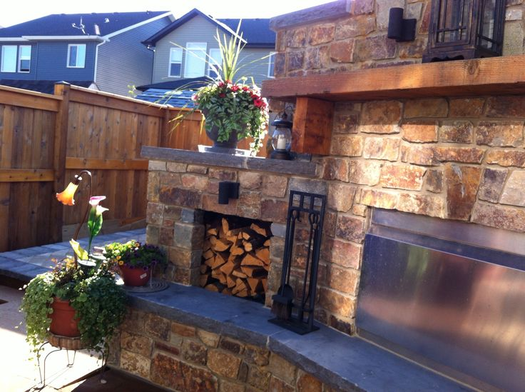 Montana stonework makes a lovely centerpiece for our backyard, to be use year round.