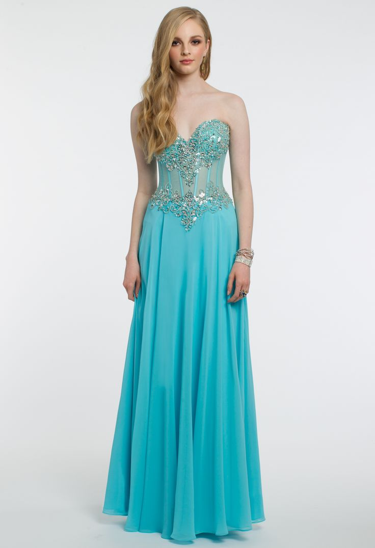 Get their attention with this astounding prom dress! With its strapless neckline, illusion tie back, and beaded corset, this long dress is captivating. #CLVprom17 #camillelavie