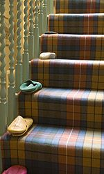 Brigette Buchanan's Cotswold Country home - Buchanan tartan carpeted stairway