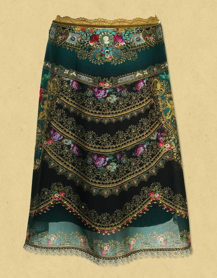 Dazzling printed chiffon lycra knee-length skirt. This Michal Negrin skirt is accented with lycra lining, lace and velvet strips, swarovski crystals and glitter.