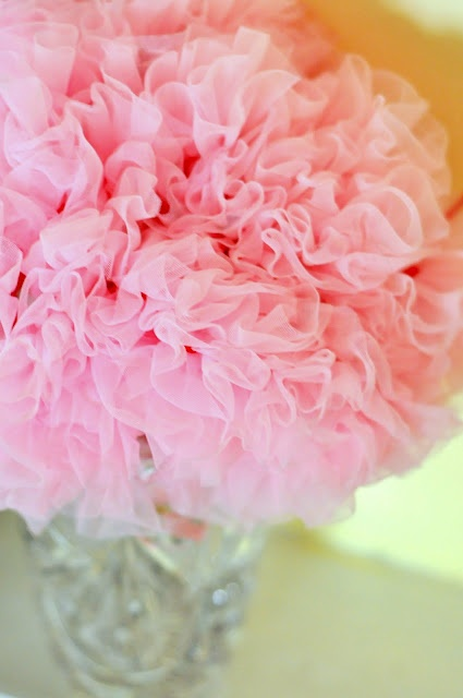 tutu stuffed upside-down in a crystal vase. Cute for a baby shower!
