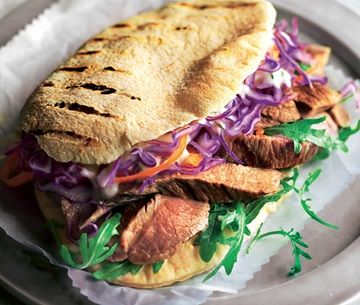 Sliced lamb with red cabbage and salad in a pitta bread