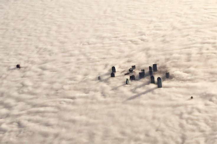Dallas, Texas--In this aerial photo, downtown Dallas is enveloped in morning fog, Tuesday, Dec. 9, 2014. The National Weather Service issued a dense fog advisory Tuesday morning for the Dallas-Fort Worth area.