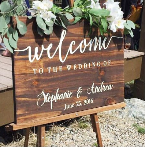Welcome To Our Wedding Sign - Wedding Decoration - Wedding Sign - Rustic Weddings - Welcome Sign - Wedding Accessories - Wooden Wedding Sign  Every sign is handmade out of premium quality wood. We do not consider knots a flaw or defect in the sign. Knots and wood grain will vary from piece to piece, but adds to the beauty and originality of the sign. It simply shows the natural characteristics within the wood. We finish our signs with an indoor/outdoor sealer but do not recommend placing…