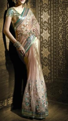 Gorgeous peach and green shimmer net Saree with diagonal patchwork    Satya Paul´s contemporary Indian styles of Sarees is unsurpassed within the Indian Fashion world. His Saree lines range from Silk Sarees to Net sarees with rich embroidery. Satya Paul as a designer is one of the most popular Indian designers in Bollywood. Strand of Silk (strandofsilk.com) offers a beautiful collection of Satya Paul Sarees with beautiful coloured prints.