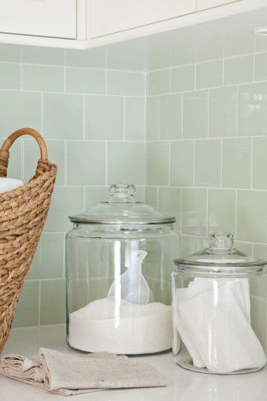 Laundry detergent and fabric sheets in glass containers