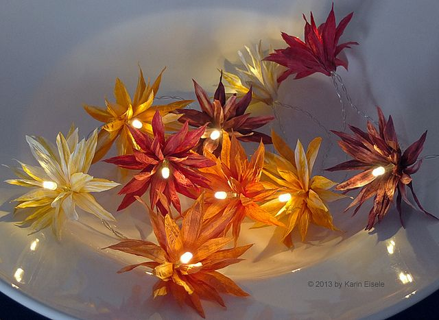 Paper Twine Flower Lights by all things paper, via Flickr