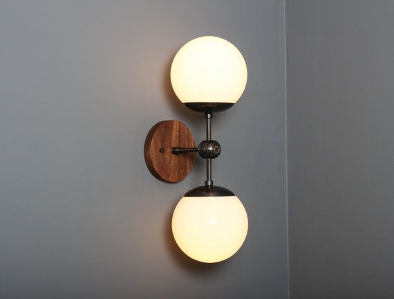 """OVERVIEW A mid-century inspired, handcrafted sconce with wood and brass accents and glass globe shade. DETAILS Dimensions: 8.5""""D x 6""""W x 20""""H, Wood base: 5""""W, Glass globe: 6W UL Listed (hard-wire only) for dry locations, damp locations upon request Professional installation required. Cord and plug available for purchase separately. E26 base 