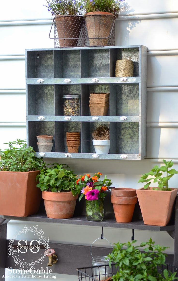 Love this potting bench area with tin shelves | Garden Inspiration