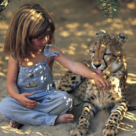 She Grew Up In The Wild With Only Animals As Friends. These 14 Pictures Are Amazing!