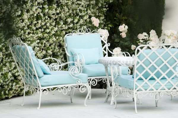Loving this white wrought iron and the powder blue cushions!