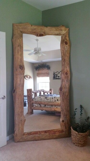 DIY Log Furniture…..Love this leaning mirror! We used pieces of knotty pine that were left over from a saw mill project and framed it around a large mirror….matches our bedroom furniture perfectly!
