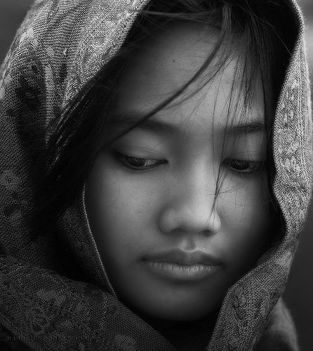 A young Balinese Woman. Such a beautiful photo. It draws you in, wondering what she is thinking.