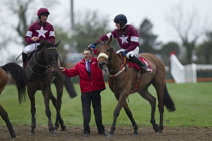 Paul Townend on Quito De La Roque congratulate Jack Madden after Sir Des Champs and Davy Rusell won the thetote.com Punchestown Gold Cup Punchestown Festival