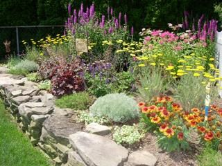 Like the rock wall with the perennials.  I need a landscape designer and lots of ca$h!