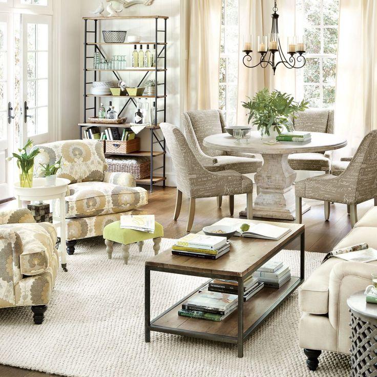 Combinacion de mesa de comedor rustica redonda con sillas tapizadas. Mesa de centro de hierro con cubierta de madera solida.