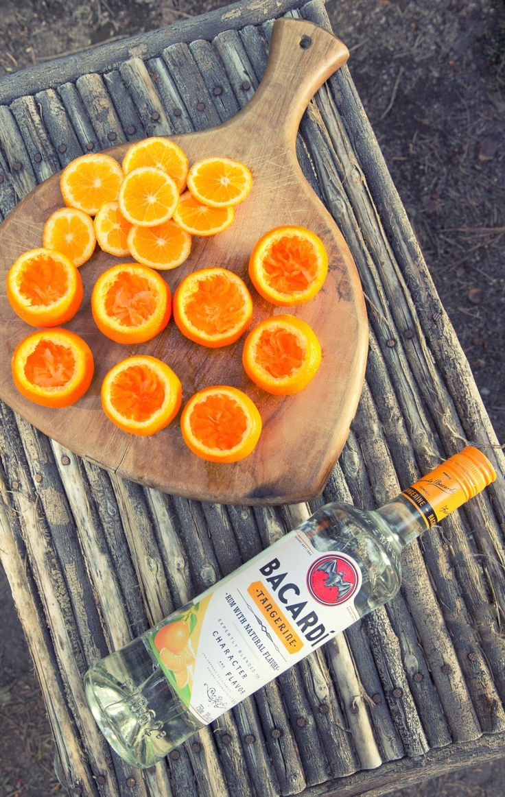 Want to impress your guests? Make them try out these natural glasses with you. Cut the tops off of tangerines or mini oranges. Hollow out the insides, and fill with Bacardí Tangerine. Wow! These are SO good!! [sp]