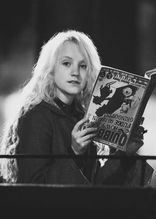 Luna (Harry Potter) reading upside down :) I have done this!!! (Turn the cover sheet upside down, that way the words are still facing the right way!) People reactions are so funny!!!