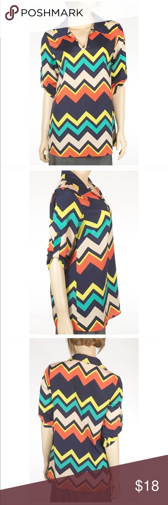 Chevron Tunic Blouse with Collar Chevron Tunic Blouse. 100% polyester, three-quarter length sleeves with tabs, collar, V-neck. Vibrant colors and in excellent condition. Chest measures 19 inches across from armpit to armpit. 28 inches long. Size medium Tunic.   🔺Questions? Please ask.  🔺I want your Poshmark experience to be easy & enjoyable. 🔺Thank you for shopping at Posh Mishmosh.🎉 Tops Tunics