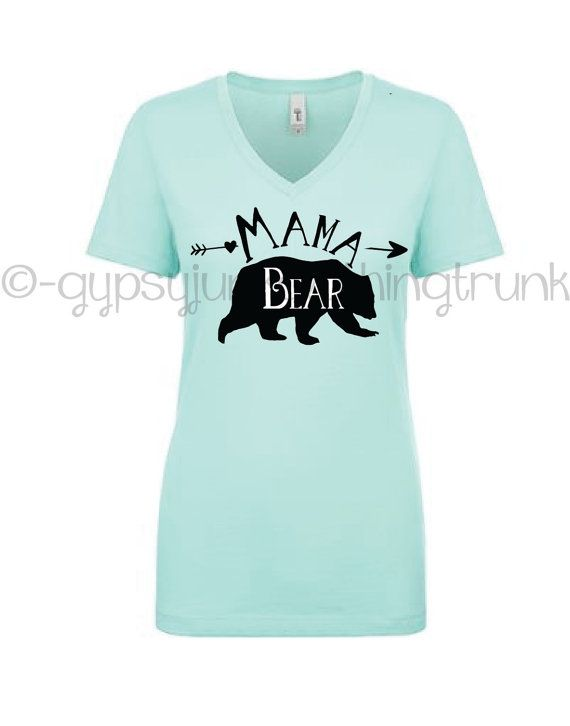 Let your inner mama bear shine with this handmade boho style mama bear mint v-neck t-shirt in a super soft cotton blend mint next level brand v-neck. This mint shirt is extremely soft and designed right here in my smoke free home studio. If you love that boho and gypsy spirit you will love this shirt to show it off! And for all the little baby bears out there that need to know just who the mama is....now there is no denying it. This is an excellent cotton blend fitted womens v-neck t-shirt…