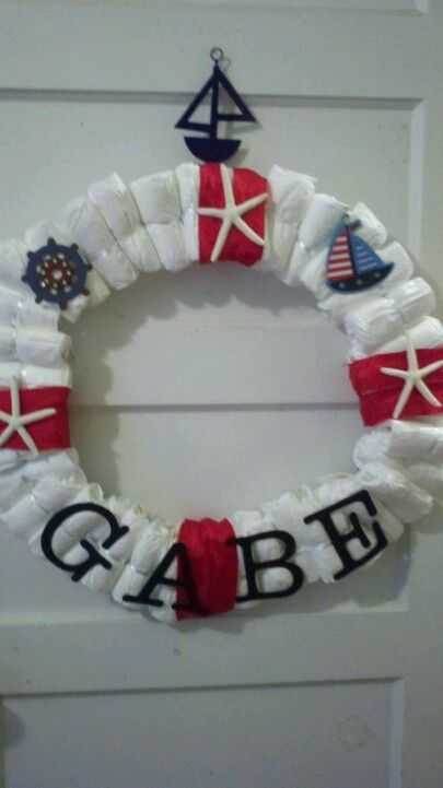nautical diaper cake | make a diaper wreath like a life preserver instead of diaper cake for