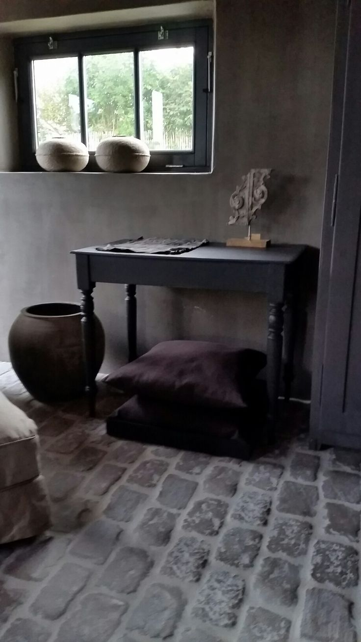 #hamsmade old pottery,  black furniture, raw stones interior decorator