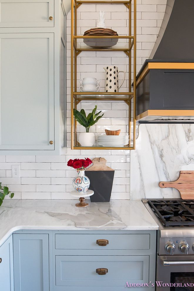 Backsplash Is A White Crackle Subway Tile With Black Grout And Marble Slab Behind The Range Whitesubwaytilebacksplash Countertopba White Marble Kitchen Kitchen Tiles Kitchen Slab