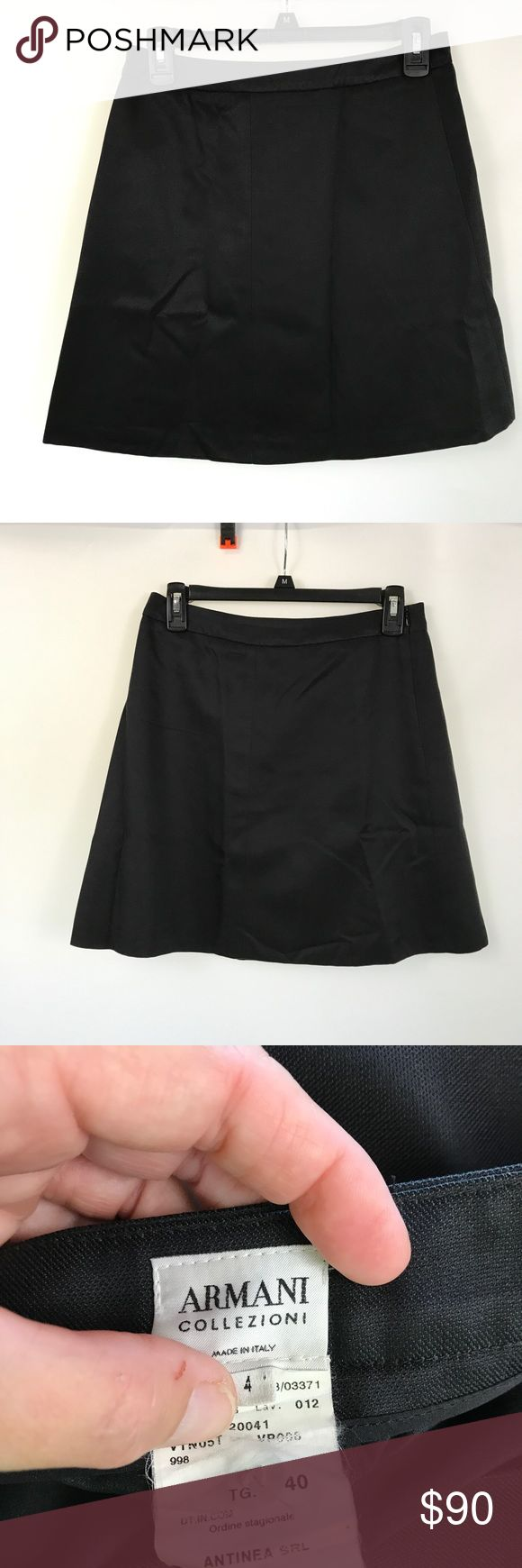 "Armani Collezioni Black Silk Casual Skirt Size 4 Armani Collezioni Black Casual Skirt Size 4  ARMANI COLLEZIONI Womens Sz 4 40 (IT) Black Silk Blend Casual Skirt  Features:  - A-Line silhouette - Short - Black - 65% Cotton, 35% Silk - Dry clean only  Approximate measurements:  Waist: 29"" Length: 18""  Condition: Very good pre-owned condition. No flaws. Retail $495 Armani Collezioni Skirts A-Line or Full"