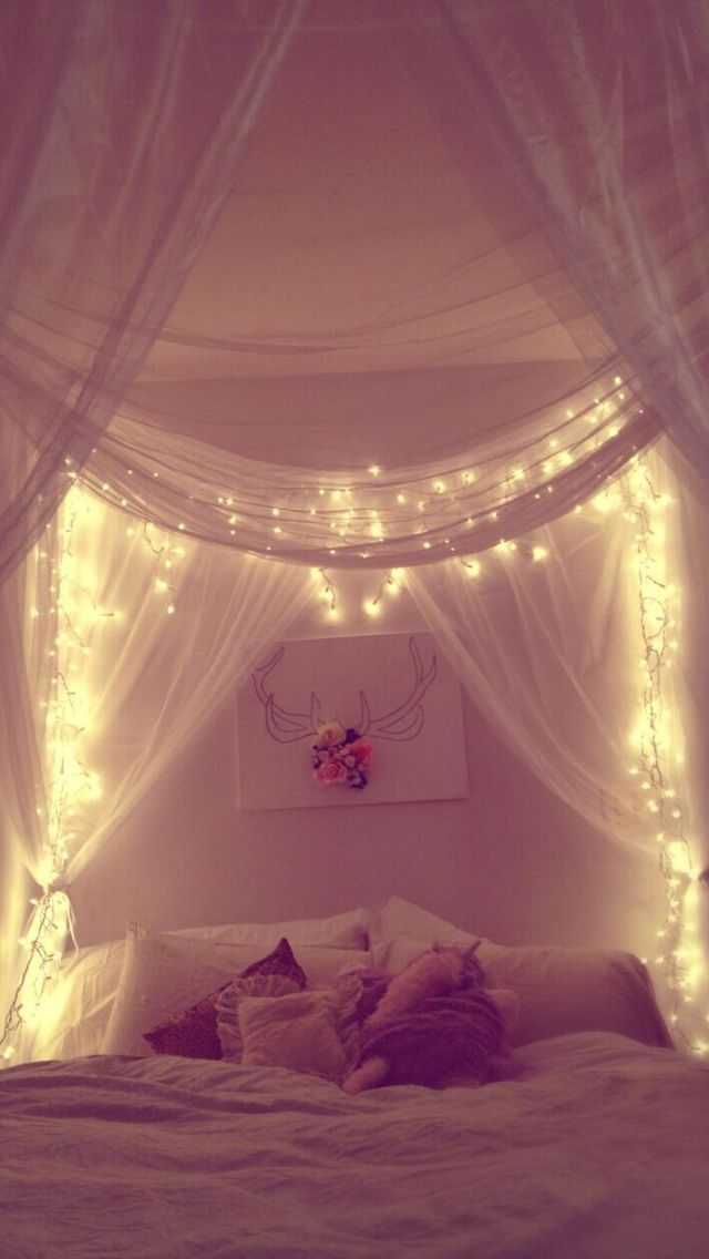 Tule and lights bedroom decor. I love this idea....without the antler artwork.